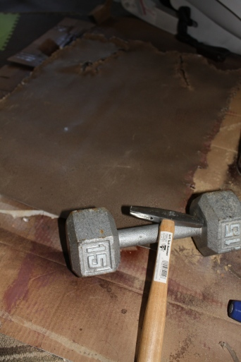 The winning tools: 15 lb. dumbell and tack hammer